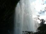 Walking behind the waterfall at Misol-Ha